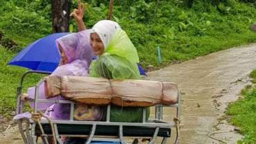 5 Tips Liburan Bersama Anak Saat Musim Hujan Tiba